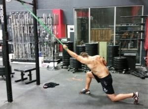 Lat stretch with band to minmize CrossFit shoulder pain