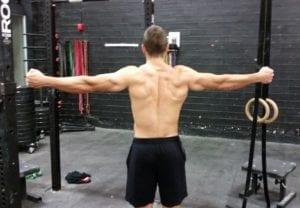 T-band pulls to Minimize CrossFit Shoulder Pain
